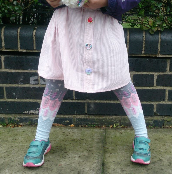 Lu upcycled shirt Tabs in pink skirt with her choice buttons