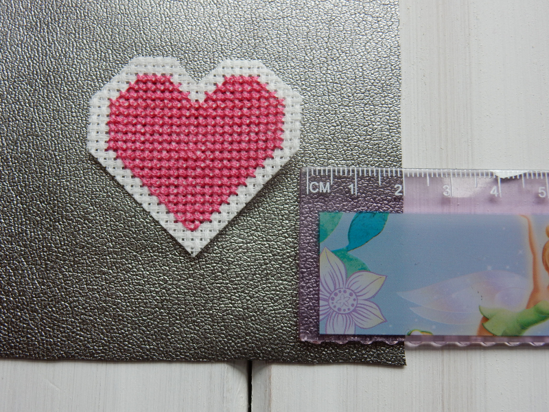 Lu leatherette pouch measuring heart on pouch 1