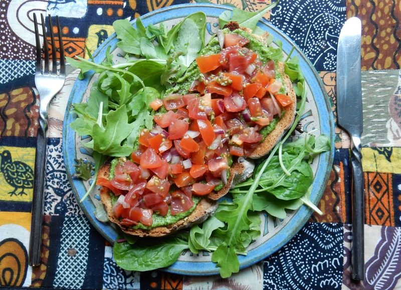 Lu Bruschetta or Bust Bruschetta on plate on mat