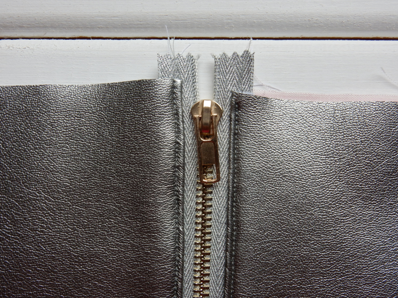 Lu leatherette pouch top stitching done