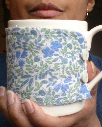 Lu upcycled shirt mug warmer me holding tea