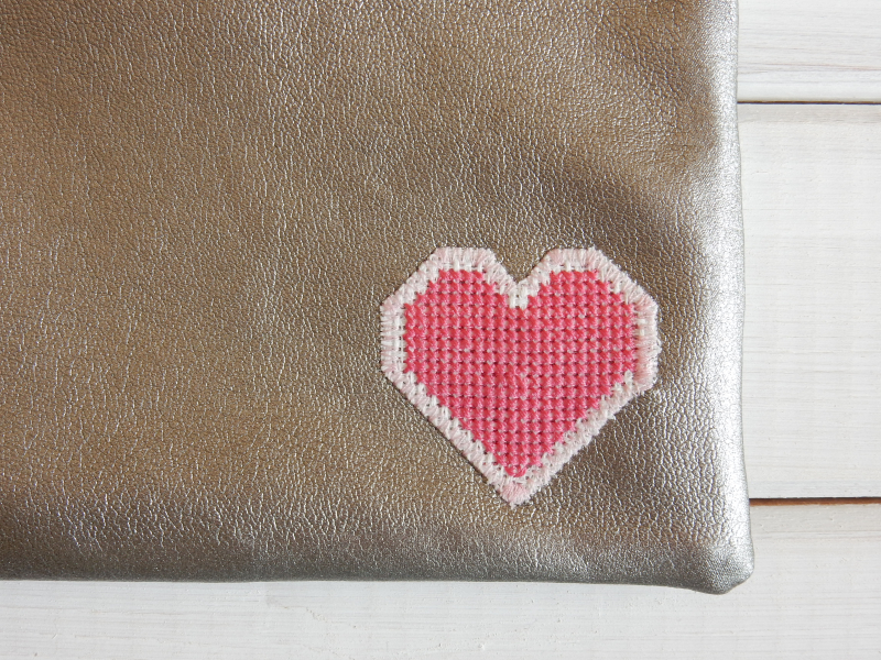 Lu leatherette pouch complete showing heart
