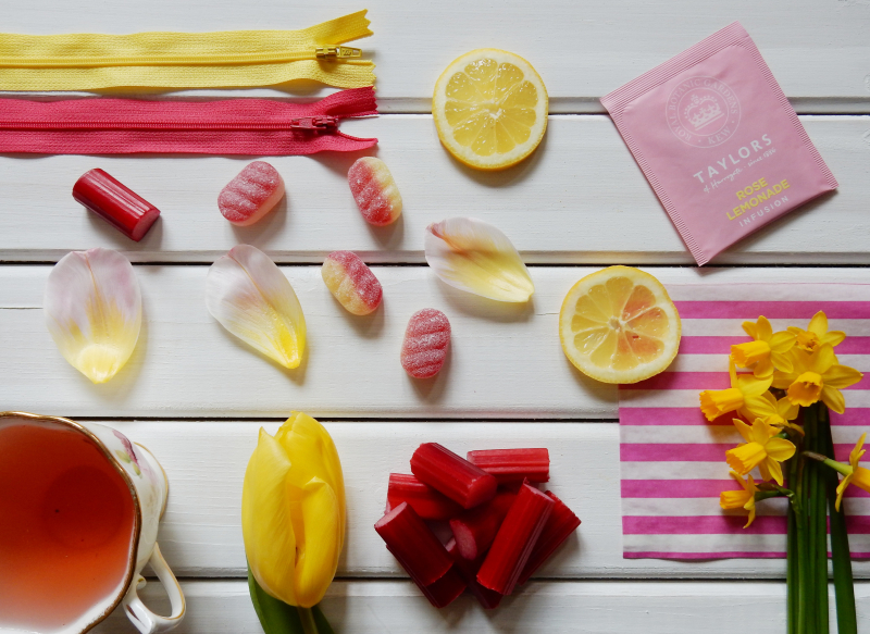 Lu rhubarb and custard playing with pink and yellow